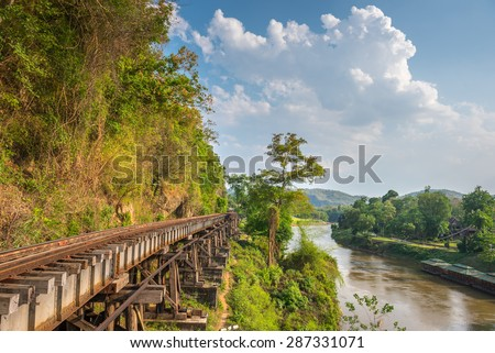 Death Railway and Bridge of Death at River Kwai, was built by the Empire of Japan in 1943, on World War 2 in Kanchanaburi, Thailand. - stock photo