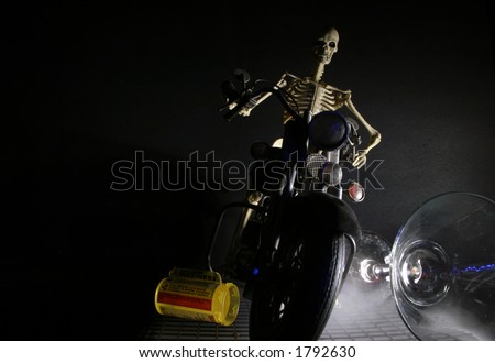 death rides motorcycles while drunk and on drugs - stock photo