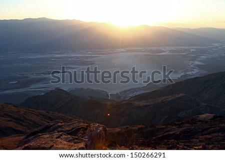 Death valley at sunset with three