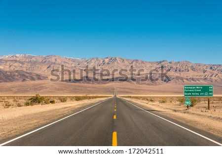 Death Valley, California - Empty infinite Road in the Desert - stock photo