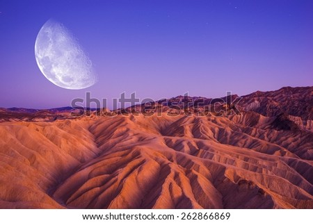 Death Valley Moon Night. Death Valley Badlands Area. California, United States. - stock photo