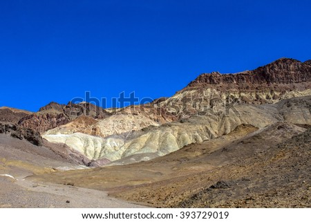 Death Valley National Park colored rock cliffs - stock photo