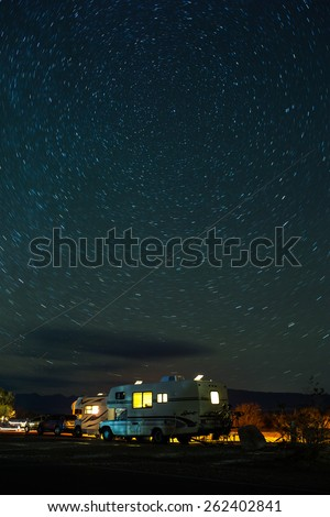 Death Valley National Park - February 8 2015: parked RVs under the sky full of stars in Death Valley National Park, CA