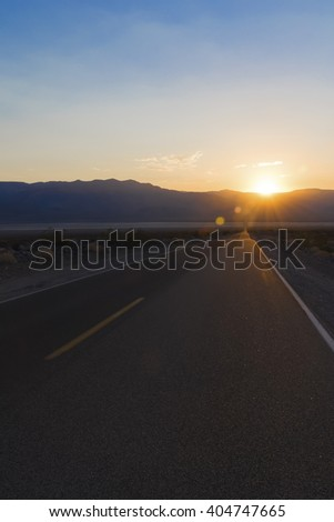 Death Valley Road, sunset - Sunset over County Road in Death Valley National Park, California - stock photo