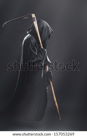death with scythe fliesin the fog at night - stock photo