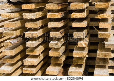 Deatil of stacked wooden logs - stock photo