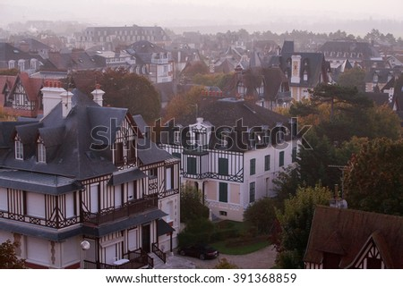 Deauville, France - October  10, 2015: Roof villas at dawn in Deauville, Normandy, France - stock photo