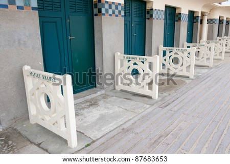 DEAUVILLE, FRANCE - OCTOBER 7: Views of Deauville on October 7, 2011. Promenade des Planches, where beach closet are dedicated to famous actors and movie makers that have come to Deauville