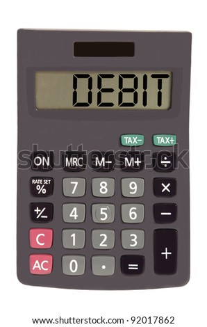debit on display of an old calculator on white background