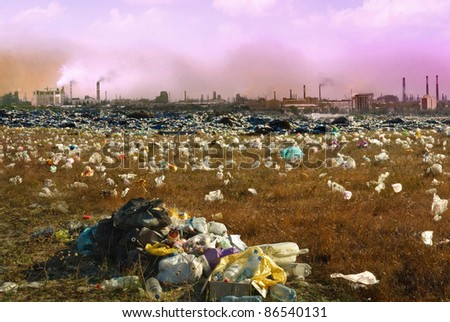 Debris dump and the mountain of garbage - ecology concept about mud and human activity. Environmental pollution from industrial  smoking and chimneys factories. Industrial destruction from the city. - stock photo