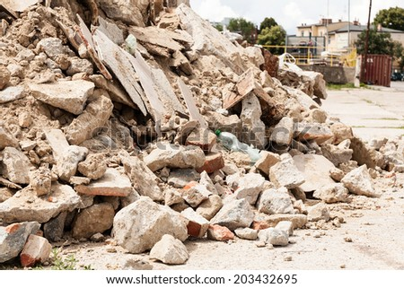 Debris, garbage bricks and material from demolished building - stock photo