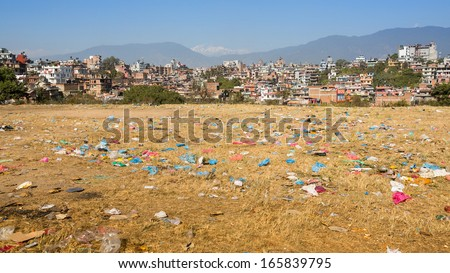 Debris on the field of view of panorama Kathmandu in the background. Environmental problems. - stock photo