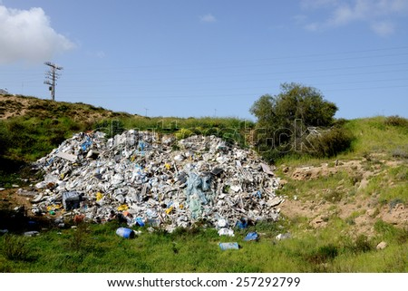 debris thrown in a vacant lot near Ashkelon city, Israel - stock photo