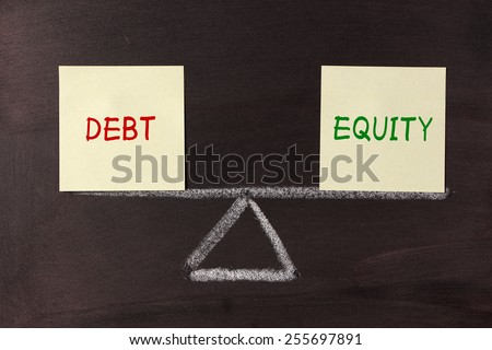 Debt and Equity Balance concept on blackboard. - stock photo
