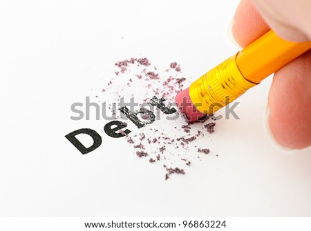 Debt being erased by the end of a pencil, word implies debt - stock photo