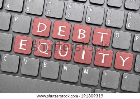 Debt equity on keyboard - stock photo