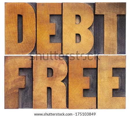 debt free - financial concept - isolated text in vintage letterpress wood type - stock photo