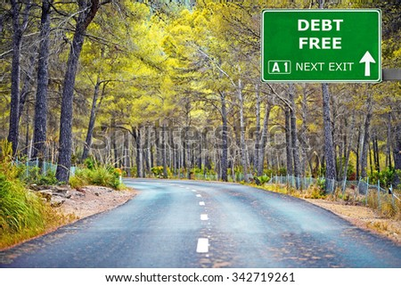 DEBT FREE road sign against clear blue sky - stock photo