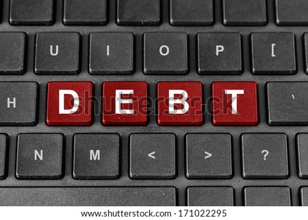 Debt red word on keyboard - stock photo