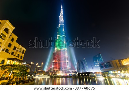 DEC 03 -DUBAI, UAE:  Burj Khalifa Tower is illuminated  in white, green and red colours of the flag of UAE to celebrate the 42nd National Day. on the third of december,2013 in Dubai,UAE.