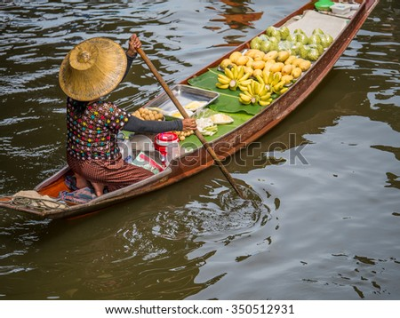 Dec 9th 2015, THAILAND : Traders selling vegetables and fruits by sailing a boat in a floating market, Thailand