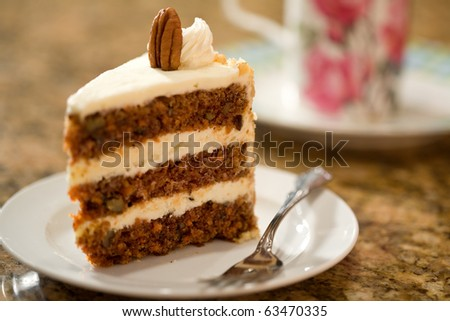 Decadent slice of carrot cake. - stock photo