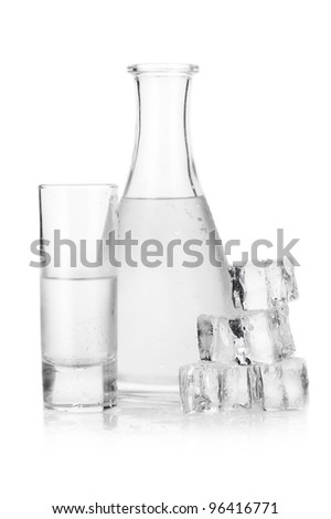 Decanter and glass of iced vodka with ice cubes on white background - stock photo