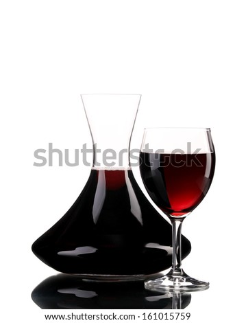 Decanter and glass of wine. Isolated on a white background. - stock photo