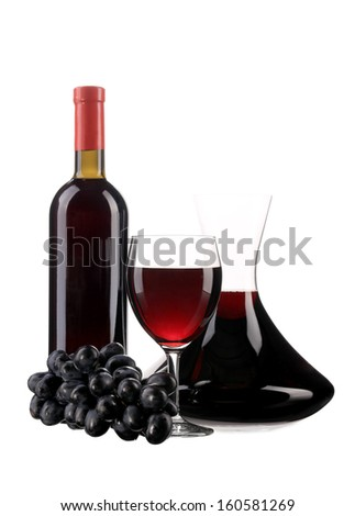 Decanter botle and glass with red wine and ripe grape - stock photo