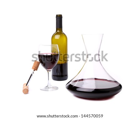 decanter, corkscrew, bottle and glass with red wine - stock photo