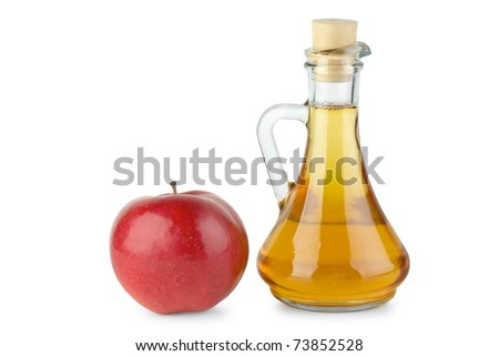 Decanter with apple vinegar and red apple  isolated on the white background - stock photo