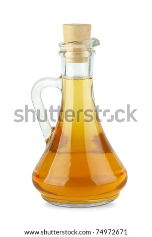 Decanter with apple vinegar  isolated on the white background - stock photo