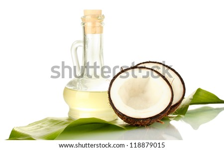 decanter with coconut oil and coconuts isolated on white - stock photo