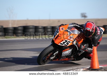 DECATUR, TX - MARCH 13 : RideSmart team rider races to victory in the six hour endurance race for super bikes at Eagles Canyon Raceway on March 13, 2010 in Decatur, TX. - stock photo
