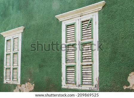 Decay of a colonial window shutter - stock photo