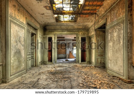 Decayed corridor in an abandoned central office of factory - stock photo