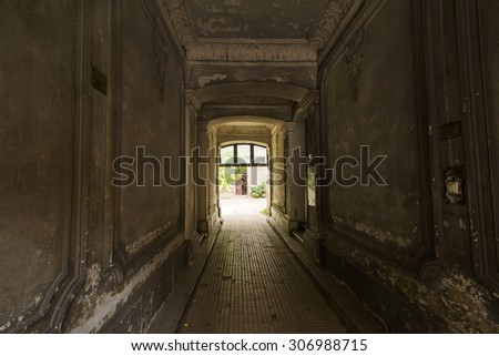 Decayed corridor in an abandoned residential building