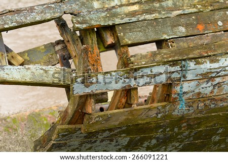 Decaying and rotting wooden planks on boat hull on River Taw, Fremington, Devon, England - stock photo