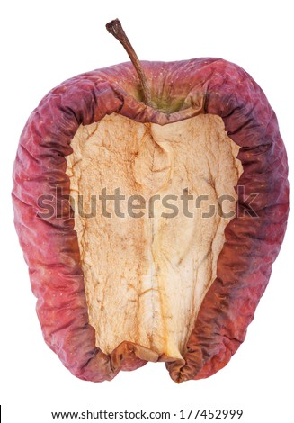 Decaying apple with a slice cut out.Isolated on white with clipping path - stock photo