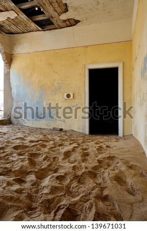 Decaying architecture at Kolmanskop near Luderitz in Namibia - stock photo