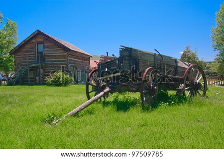 Decaying horse drawn wagon in ghost town of Virginia City, Montana - stock photo