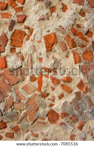 decaying wall made of concrete and brick