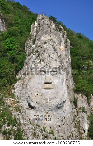 Decebal's head carved in rock in the Iron Gates Natural Park, Romania - stock photo