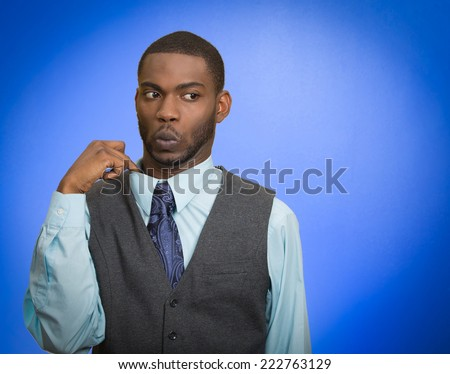 Deceiver. Portrait young business man opening shirt to vent it's hot, unpleasant, awkward situation embarrassment isolated blue background. Negative emotion face expression feeling body language sign - stock photo