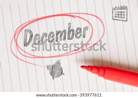 December attention note with a red brush and circle - stock photo
