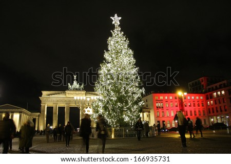 DECEMBER 2013 - BERLIN: christmas time in Berlin: a christmas tree in front of the Brandenburg Gate in the Mitte district of Berlin.