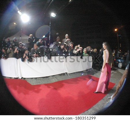 "DECEMBER 3, 2005 - BERLIN: fisheye image of a typical red carpet scene: filmstar with press photographers (before a film award ceremony to the ""Europaeischer Filmpreis""), Berlin."