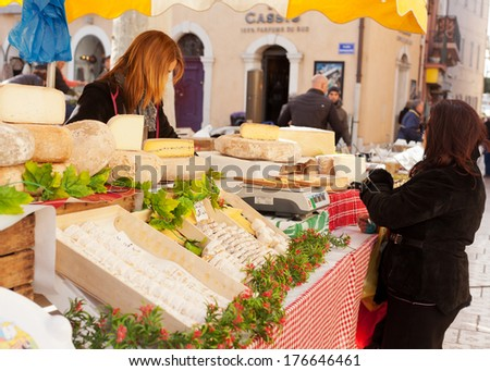 December 28, 2012. French cheeses for sale on the market in Cassis, Provence, France. Editorial photo. - stock photo