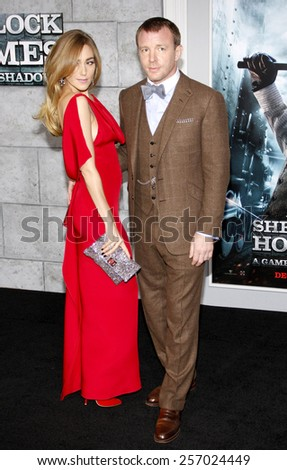 "December 6, 2011. Guy Ritchie and Jacqui Ainsley at the Los Angeles premiere of ""Sherlock Holmes: A Game Of Shadows"" held at the Regency Village Theatre, Los Angeles. - stock photo"
