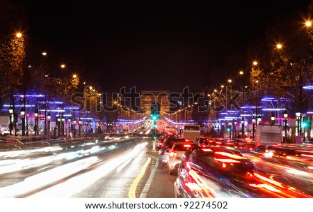 December illumination and traffic lights on the Avenue des Champs-?lys?es in Paris,Europe. - stock photo